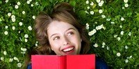 Happy woman with book