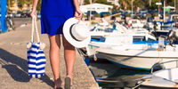 Woman walking down dock