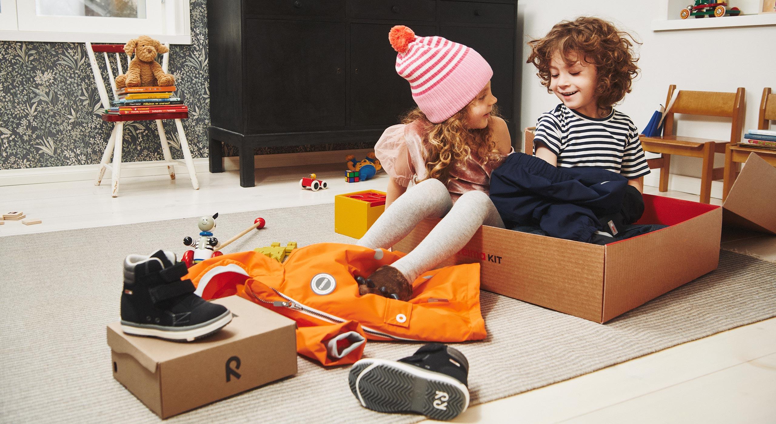 Kids playing with Reima Kit box