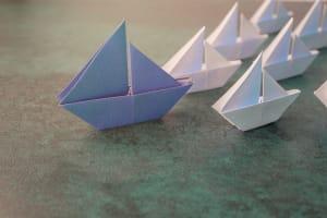 paper ship leading fleet