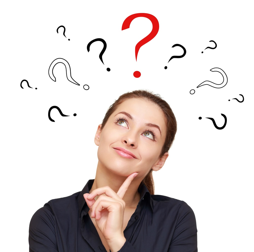 FAQs Thinking smiling woman with questions marks above looking up on red sign