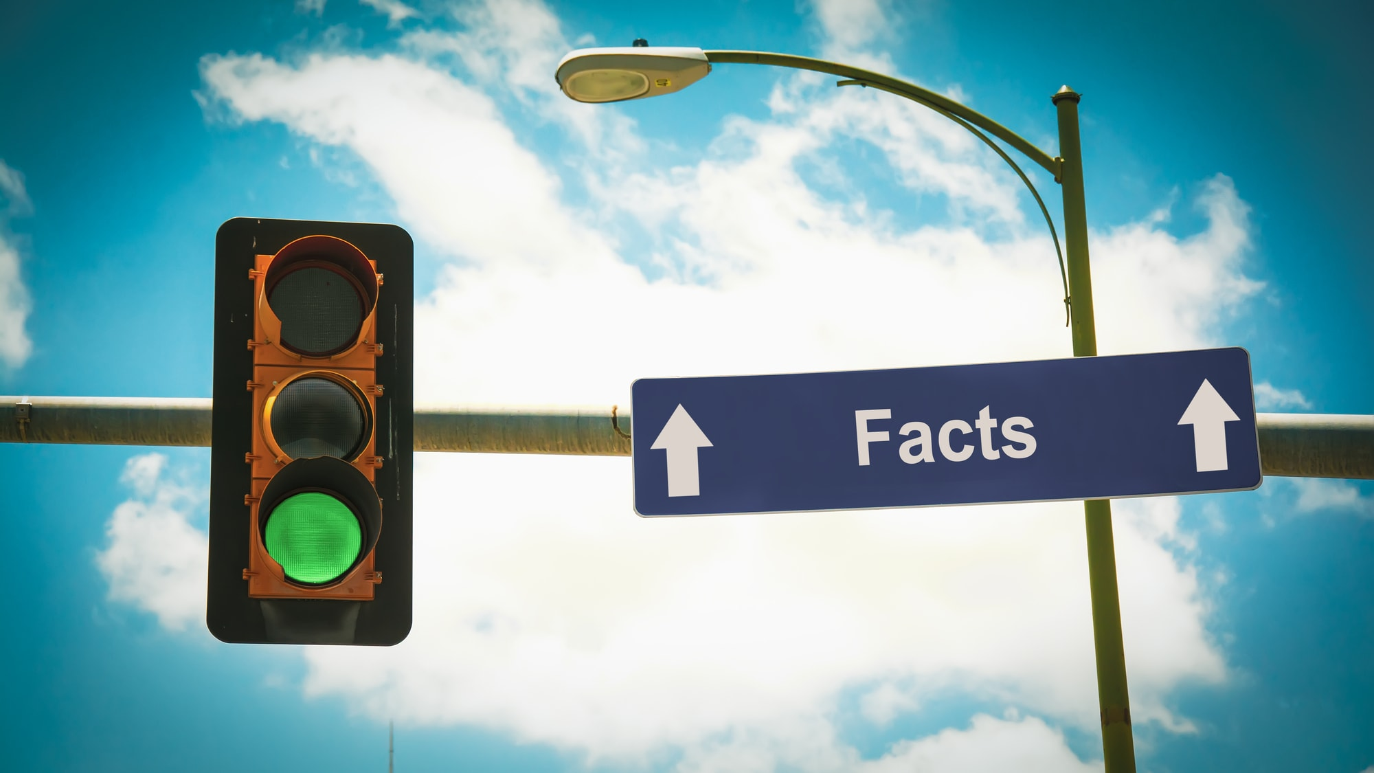 green light pointing to facts