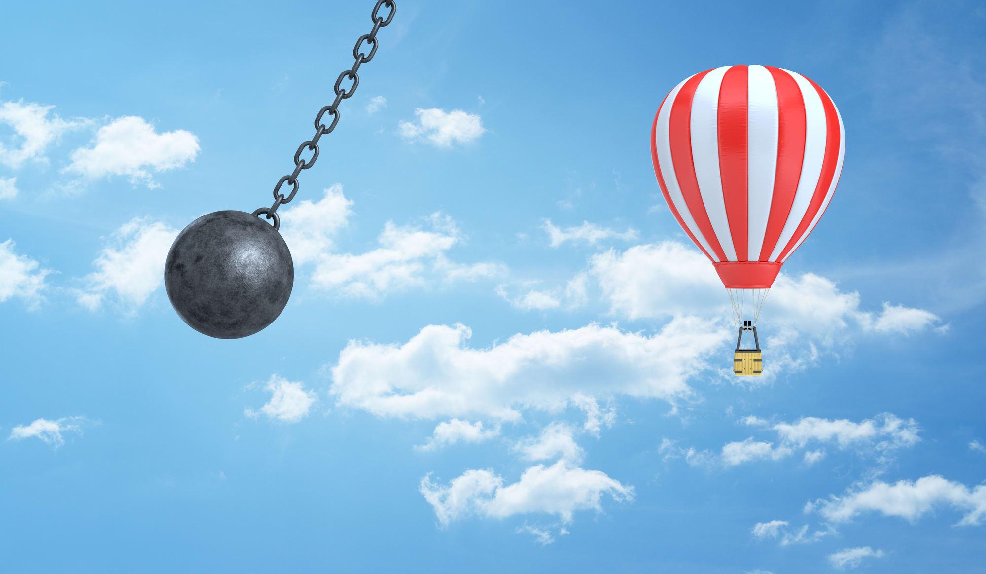 Wrecking ball swinging at air balloon