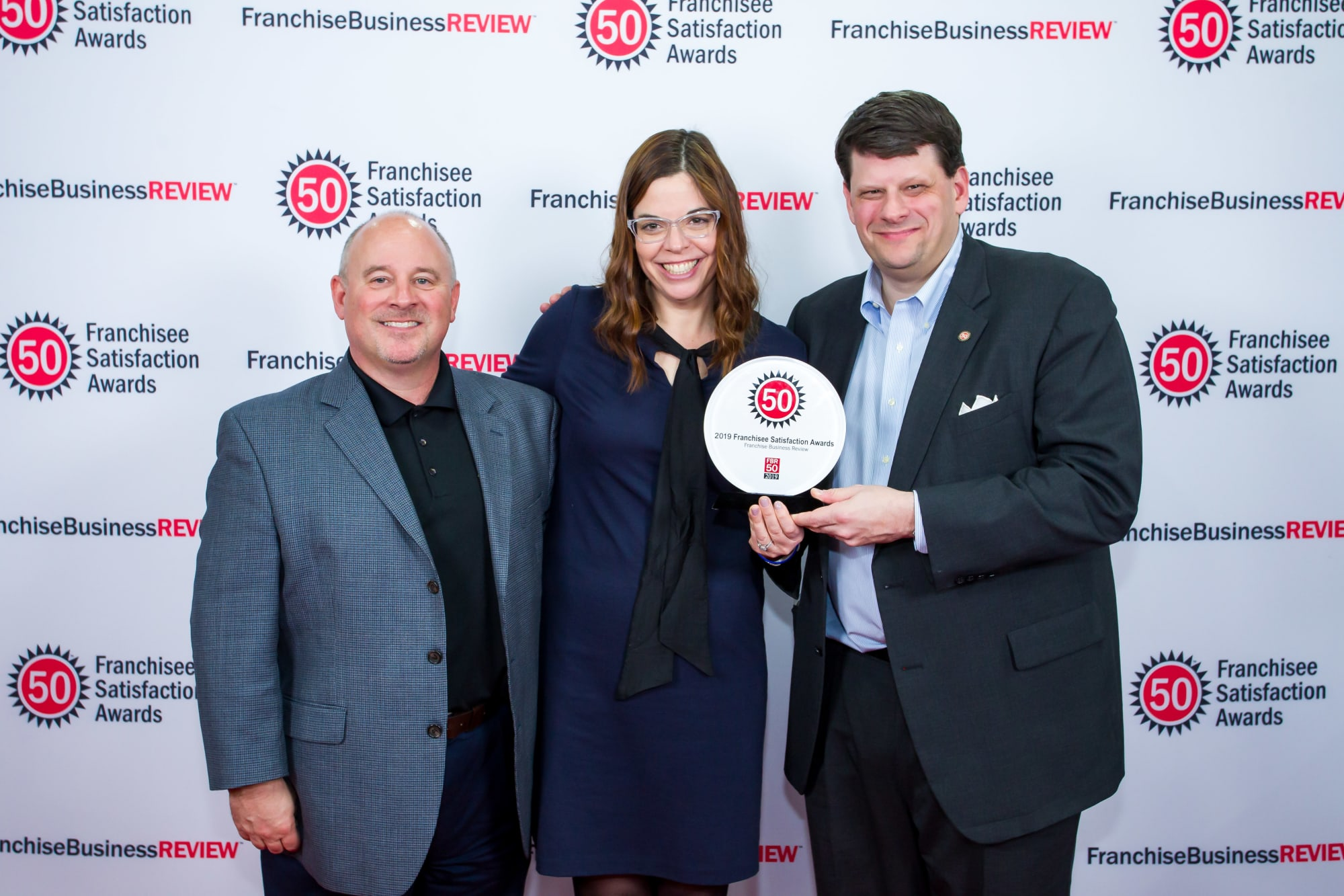 Tropical Smoothie Cafe leadership accepting FBR Franchisee Satisfaction Award