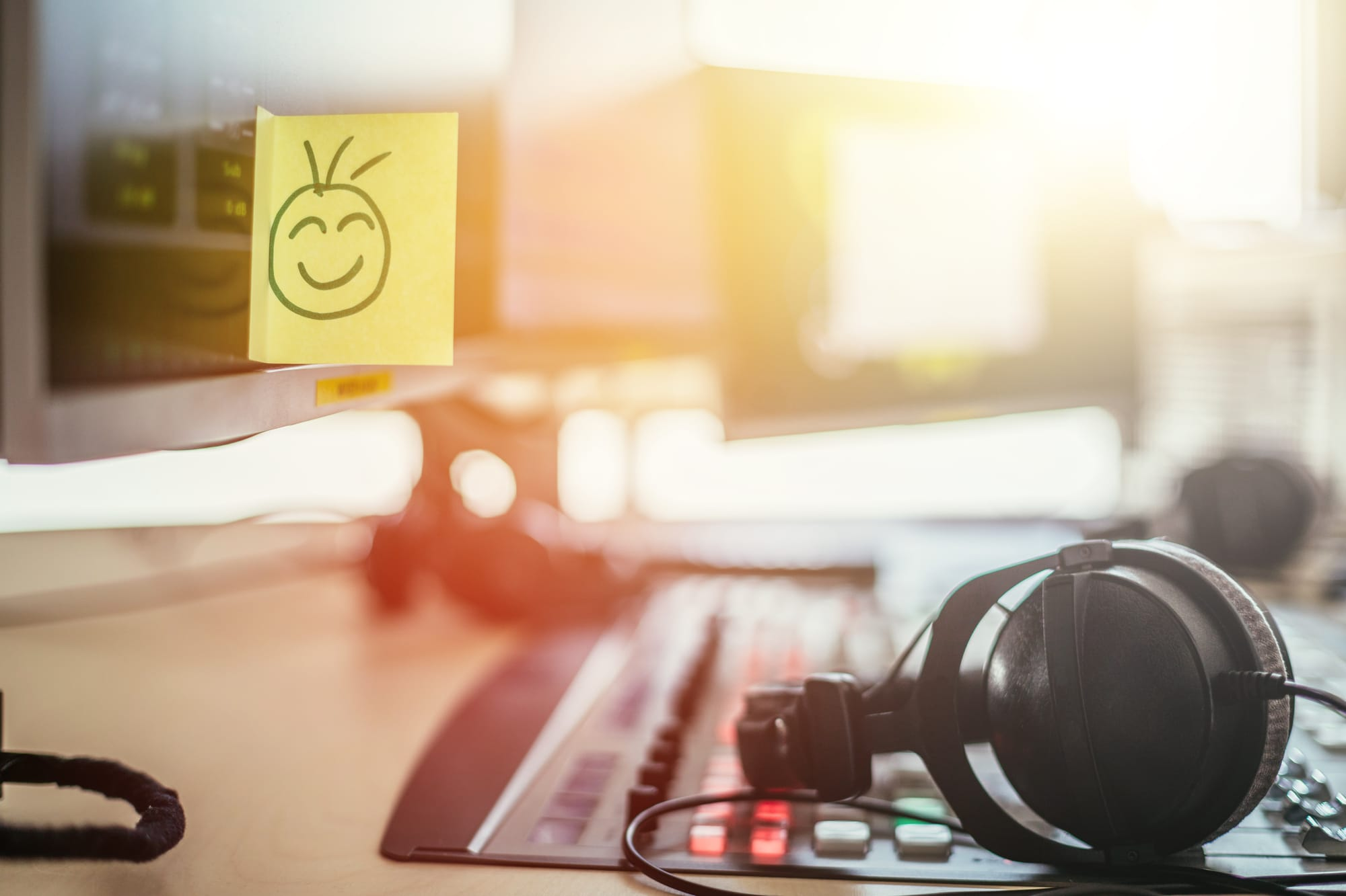 Monitor with smiley face post-it