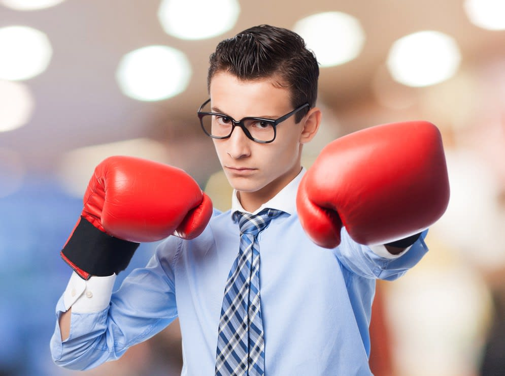 young franchisee wearing boxing gloves