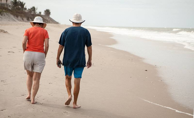 Elderly couple walking on the seashore