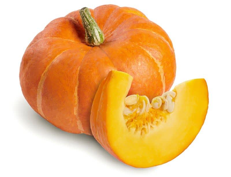 Orange pumpkin and cut pumpkin slice with seeds