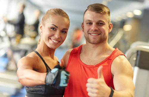 Muscular couple smiling