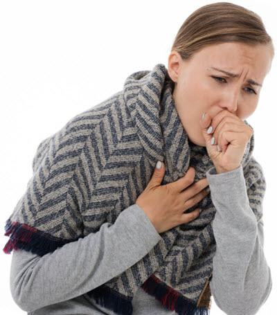 Young woman coughing with a cold