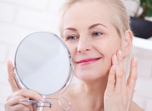 An elderly woman has youthful-looking skin