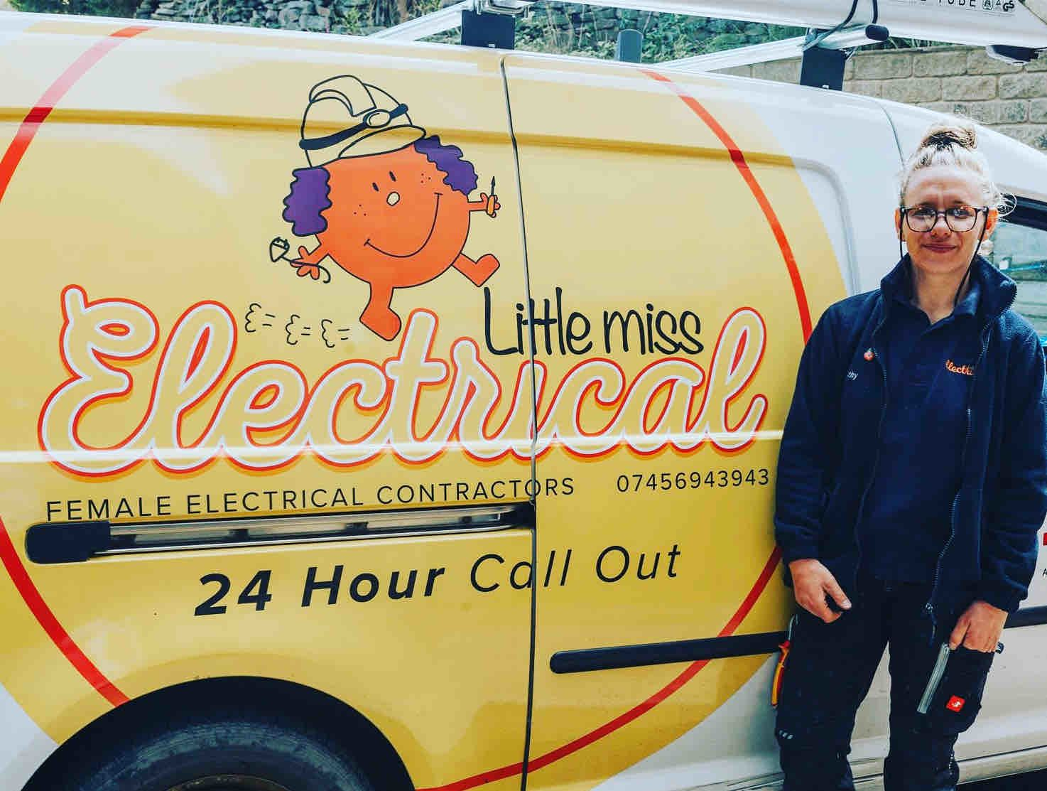 Cathy posing in front of her company's van