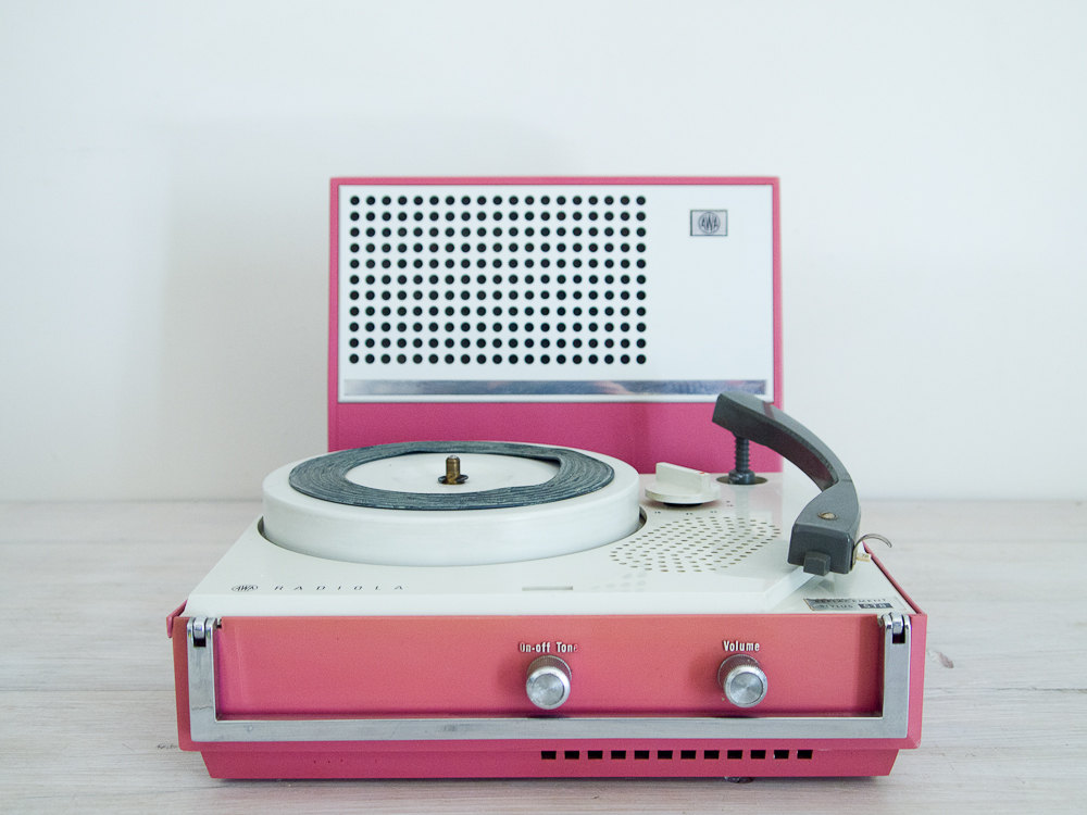 vintage dusty pink portable electric record player by epochco