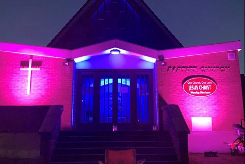 Louise's church lit up pink and blue