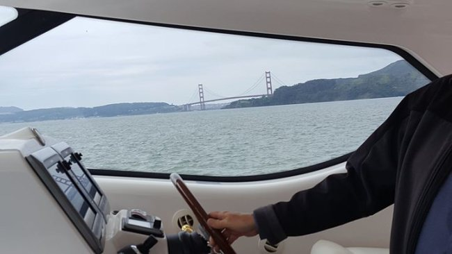 Vicki & client on a sea trial for the 43' Tiara in San Francisco Bay!
