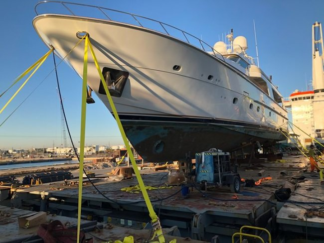 After three full days of loading this 113' Hatteras Motor Yacht onto the ship, she's finally on her way to the west coast! Next stop, Ensenada!