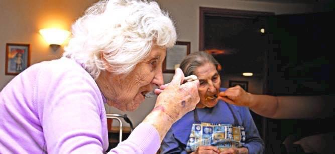 Elderly people enjoying mealtime
