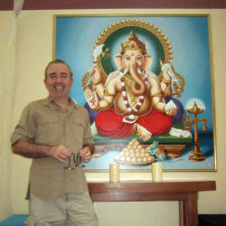 Yoga Tree co-owner Tim Dale with Ganesha painting.