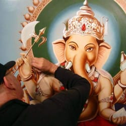 "William Shirley creating the oil ""portrait"" of Ganesha that now hangs in Yoga Tree's Corte Madera studio."