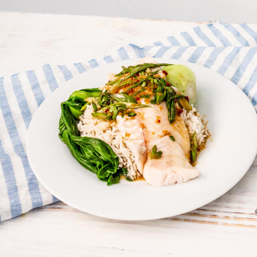 Aromatic steamed haddock, rice, bok choi and fragrant soy dressing