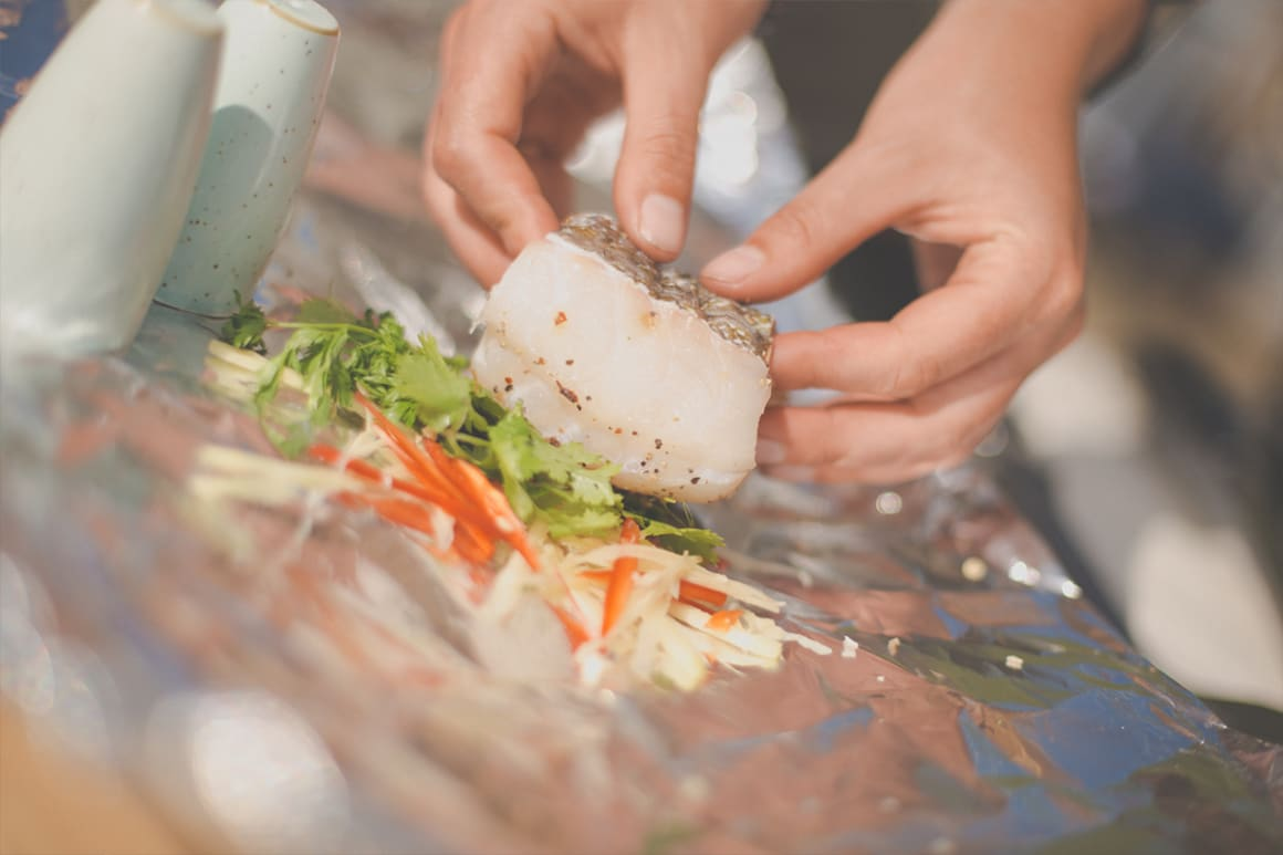 Cook fish in foil parcels on the barbecue