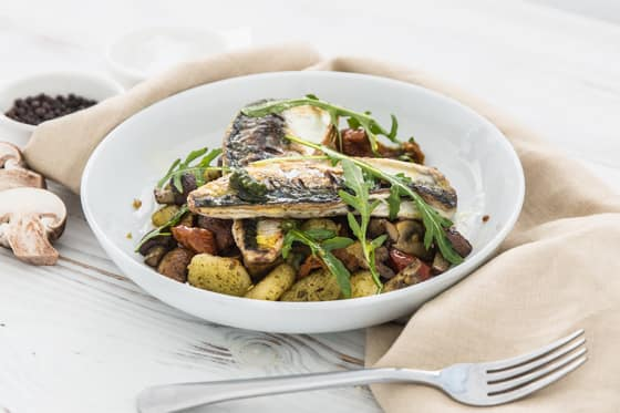 Cornish mackerel with gnocchi, sun-blushed tomatoes, mushrooms & pesto