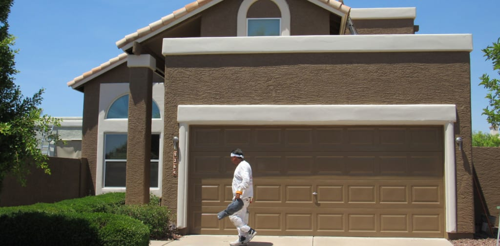 Our painter walks in front of a nearly completed home, as they prepare to put the finishing touches on this project.