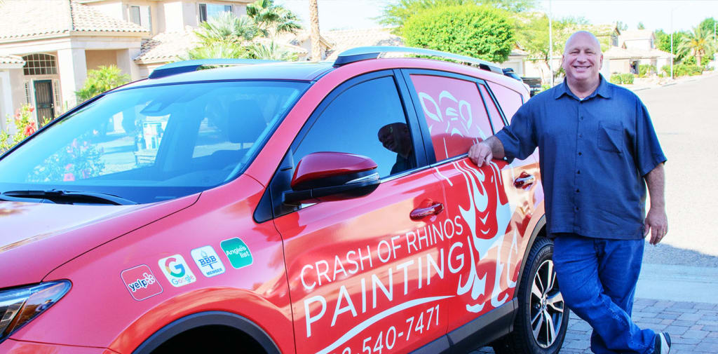 Our owner, Mike Ricker, poses next to one of our vehicles, which carries our inspection team from project-to-project.