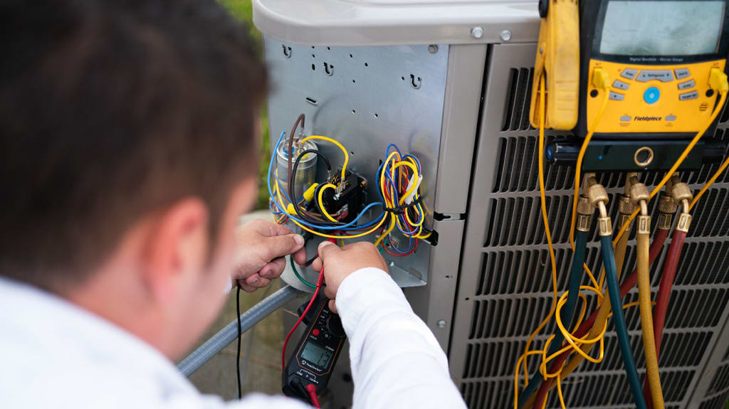 An Allbritten technician runs several tests, including an electrical test, to ensure this air conditioner is functioning safely.