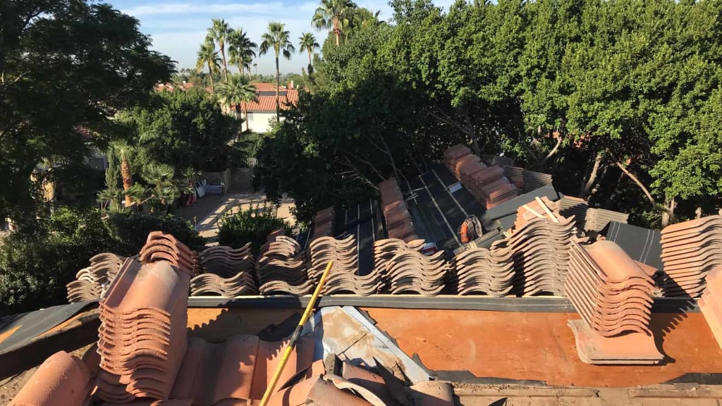 The KY-KO Roof stacks tile on top of this Scottsdale home's roof prior to starting the roofing project.