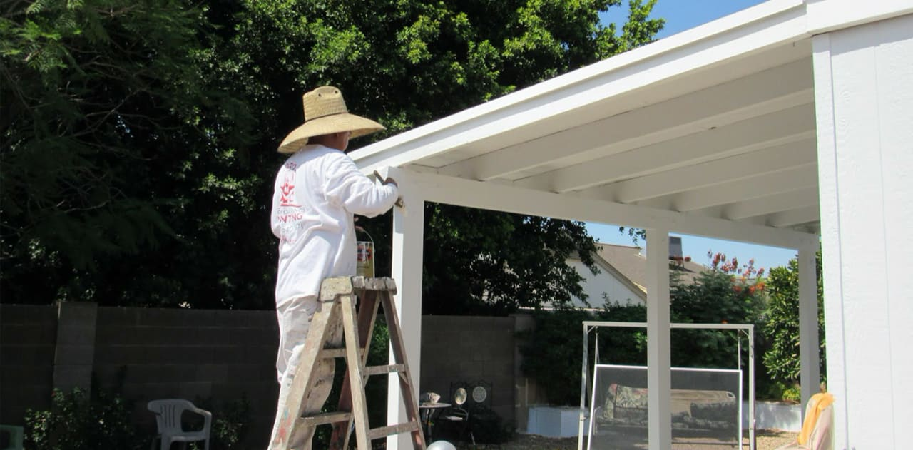 Our painter hand-brushes paint onto this patio cover, ensuring that the paint fully adheres to the surface.