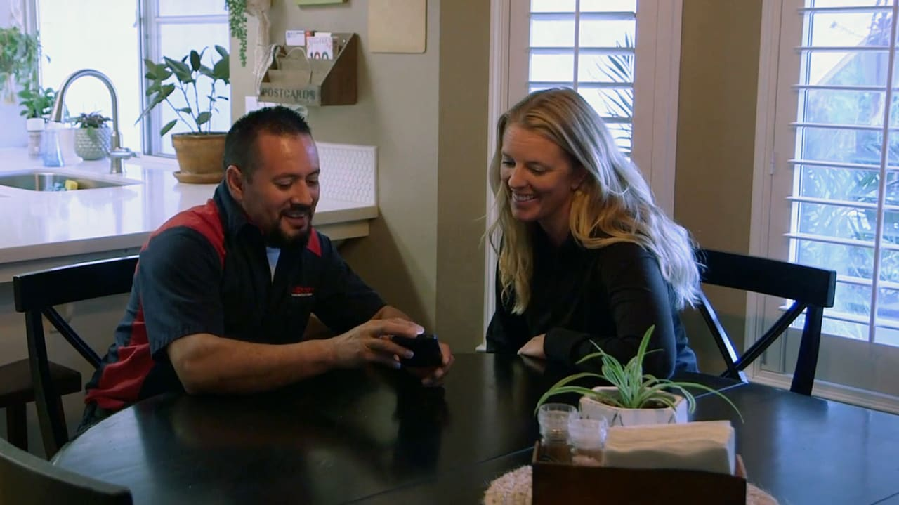 An Allbritten plumber reviews a new water filtration system with this local Fresno homeowner.