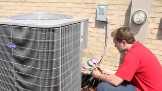 Using specialized equipment, a King technician performs seasonal maintenance on a local AC unit here in Chicago, IL