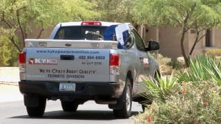 A KY-KO service truck drives out to its next job: a free termite inspection here in Phoenix.