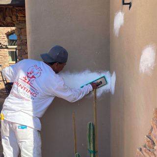 We specialize in stucco repair here in Phoenix, and our painters start by fixing woodpecker holes and other damage.