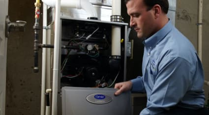 As part of our 40-point heater maintenance service in Chicago, a King technician opens up a Carrier gas furnace.