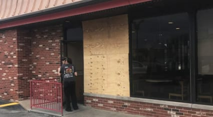 As part of our commercial glass repair service, we'll board up your business' broken window until your new glass comes in and we can install it.