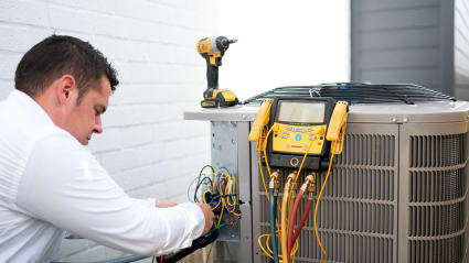 Our technician begins the diagnosis of this air conditioner on a repair service call.