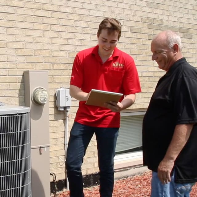 A King tech provides a homeowner with an update about their repaired air conditioner and what they can expect moving forward.