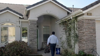 An Allbritten home energy specialist approaches a local home to begin our comprehensive home energy audit.