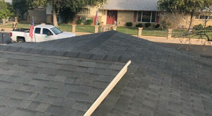We install and replace shingle roofs here in Phoenix, just like this one.
