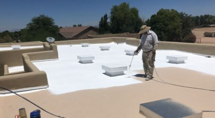 A KY-KO roofer apply spray foam roofing to the flat roof of this Phoenix, AZ home.