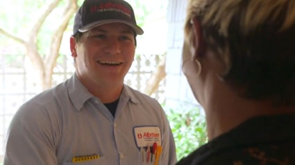 Our AC repair tech greets this local homeowner at the door before inspecting the home's air conditioner.