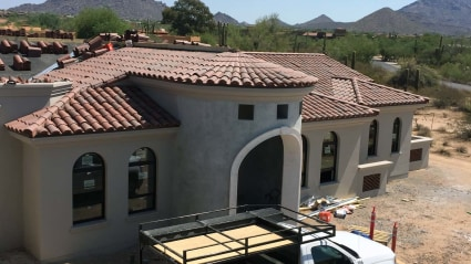 Our roofing team wraps up the installation of the tile roof on this new build here in Phoenix, AZ.