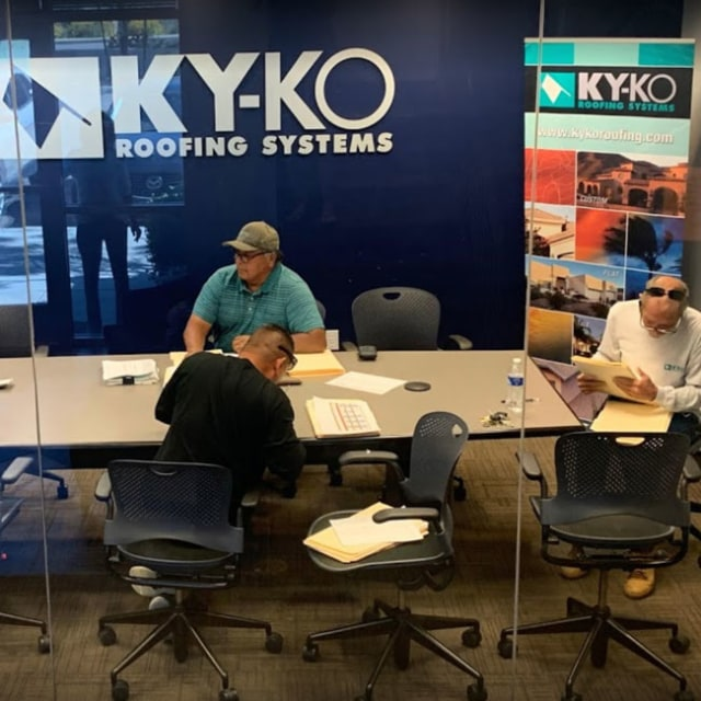 The KY-KO Roofing team meets to go over an upcoming roofing project here in Phoenix, Arizona.