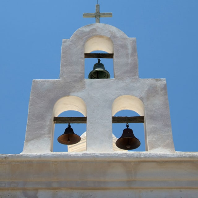 These three bells form the decorative top of a church's roof here in the Valley.