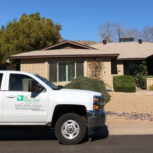 A KY-KO truck sits parked in front of this Phoenix home as the roofer starts the roof's free checkup.