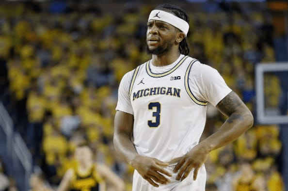 """Michigan suspended point guard Zavier Simpson for Tuesday's game against Nebraska for a """"violation of team policies,"""" head coach Juwan Howard said."""