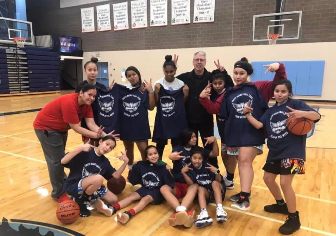 Brian Agler and some of the campers having fun at last year's first annual Holiday Hoops Basketball Clinic in Lapwai, Idaho. Photo courtesy of Rika Powaukee.