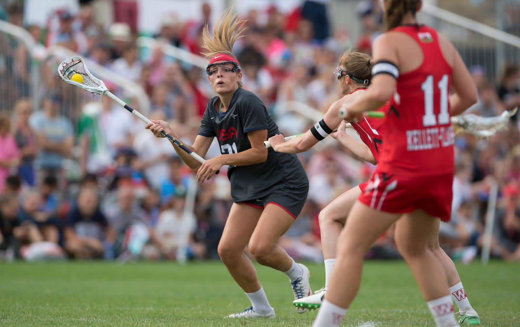 USA's taylor Cummings runs towards Welsh traffic at the 2017 FIL Rathbones Women's Lacrosse World Cup, at Surrey Sports Park, Guildford, Surrey, UK, 18th July 2017.